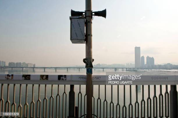 This photo taken on January 11 2013 shows a panic button in case of suicides placed by the government at Mapo Bridge a common site for suicides over...