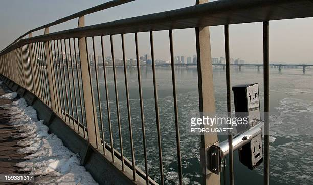 This photo taken on January 11 2013 shows an antisuicide monitoring device installed at Mapo Bridge a common place for suicides over Seoul's Han...