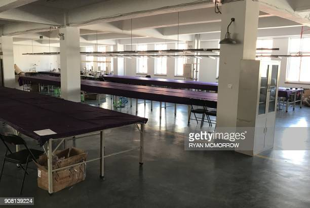 This photo taken on January 11 2018 an empty garment factory of Mr Lin is seen in the Dandong New District Innovation Institute in Dandong in China's...