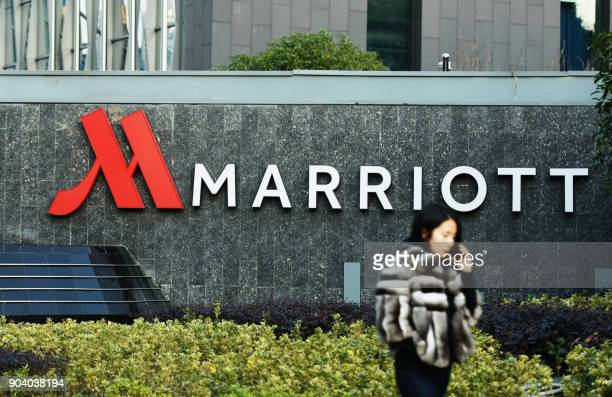 This photo taken on January 11 2018 shows a woman walking past Marriott signage in Hangzhou in China's Zhejiang province Authorities in China have...