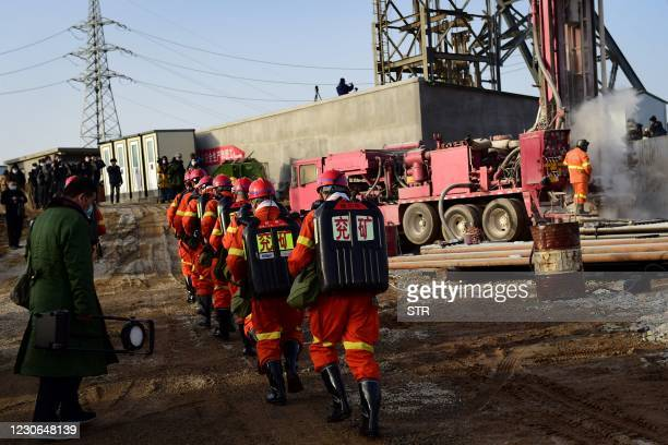 This photo taken on January 13, 2021 shows rescuers working at the site of gold mine explosion where 22 miners were trapped underground in Qixia, in...