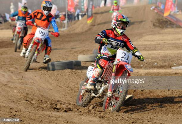 This photo taken on January 14 2018 shows motorcyclists competing during a national motocross contest in Bozhou in China's eastern Anhui province /...