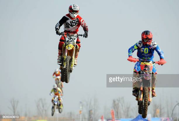 TOPSHOT This photo taken on January 14 2018 shows motorcyclists competing during a national motocross contest in Bozhou in China's eastern Anhui...