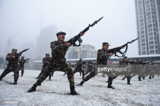 This photo taken on January 15, 2020 shows Chinese paramilitary police officers taking part in a training session during snowfall in Hefei, in...