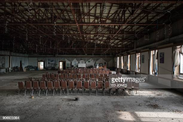 This photo taken on January 16 2018 shows rows of chairs in a ballroom at the abandoned Alps Ski Resort a former holiday destination in South Korea's...