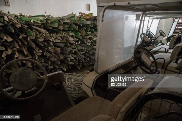 This photo taken on January 16 2018 shows skis and golf carts in a facility at the abandoned Alps Ski Resort a former holiday destination in South...