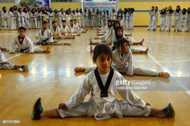 TOPSHOT This photo taken on January 19 2018 shows Afghan taekwondo students at a training session at a gym in Injil district in Herat province / AFP...