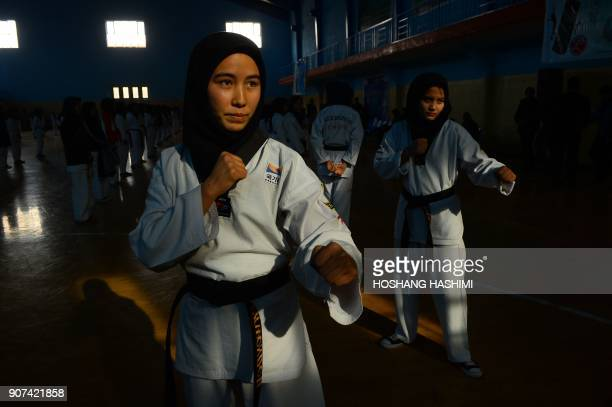 TOPSHOT This photo taken on January 19 2018 shows Afghan women taekwondo students at a training session at a gym in Injil district in Herat province...
