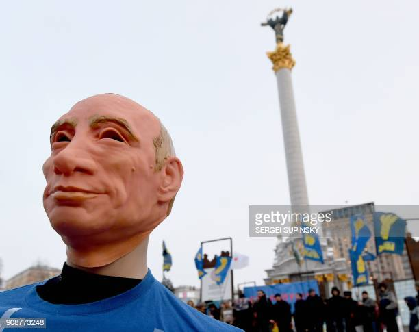 This photo taken on January 22 2018 in Independence Square in Kiev shows a mannequin depicting Russian President Vladimir Putin dressed in a football...
