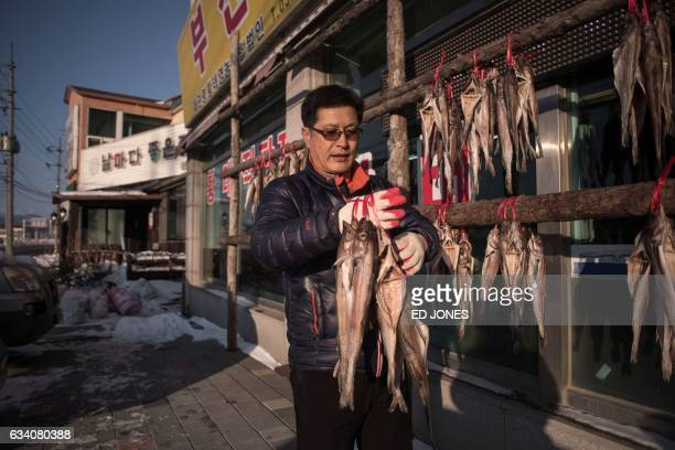 This photo taken on January 23 2017 shows dried fish vendor Lee YongOon outside his shop near the opening ceremony venue of the 2018 Pyeongchang...