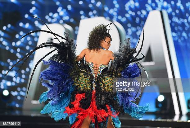 This photo taken on January 26 2017 shows Miss Universe contestant Raissa Santana of Brazil during the national costume presentation in the...