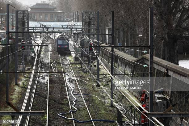 This photo taken on January 26 2018 shows the RER C train blocked in the Javel railway station flooded due to the high level of the Seine River in...