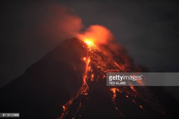 This photo taken on January 28 2018 shows Mayon volcano spewing lava ash from its crater as seen in Daraga town south of Manila in Albay province...
