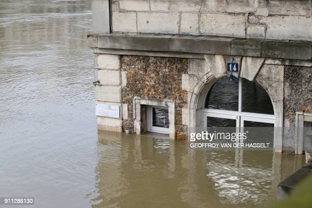 TOPSHOT This photo taken on January 28 2018 shows the cafe 'Les Nautes' in Paris partly immersed in the the water of the Seine river The swollen...