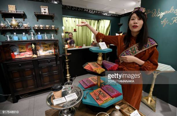 This photo taken on January 29 2018 shows a sales clerk of Japanese chocolate shop Kloka inviting customers to a temporary booth set up for...