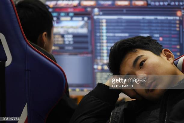 This photo taken on January 29 2018 shows a student listening to a teacher explain game techniques in an eSports class at the Lanxiang technical...