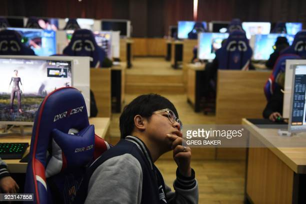 This photo taken on January 29 2018 shows a student listening to teacher Yang Xiao explain game techniques in an eSports class at the Lanxiang...