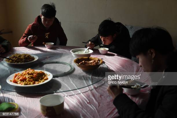 This photo taken on January 29 2018 shows eSports students eating lunch between classes at the Lanxiang technical school in Jinan in China's eastern...