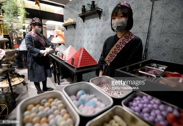 This photo taken on January 29 2018 shows sales clerks of Japanese chocolate shop Kloka working at a temporary booth set up for Valentine's Day at a...