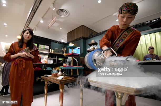 This photo taken on January 29 2018 shows sales clerks of Japanese chocolate shop Kloka work at a temporary booth set up for Valentine's Day at a...