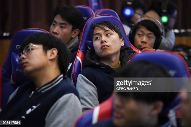 This photo taken on January 29 2018 shows students listening to a teacher explain game techniques in an eSports class at the Lanxiang technical...