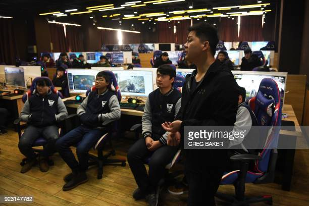 This photo taken on January 29 2018 shows students listening to teacher Yang Xiao explain game techniques in an eSports class at the Lanxiang...