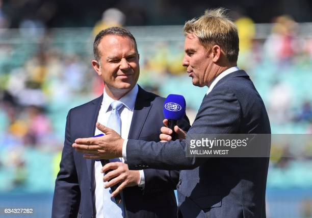 This photo taken on January 3 2017 shows former Australian cricket player and now Channel Nine cricket commentator Shane Warne talking to former...