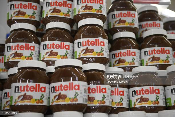 This photo taken on January 30 2018 in SaintGregoire near Rennes northwest France shows containers of Nutella An independant organisation of the...