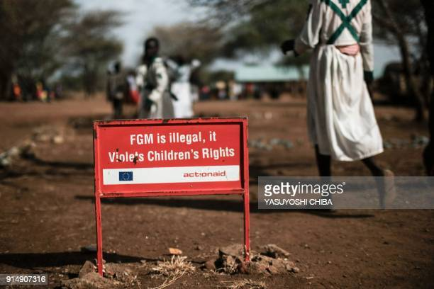 TOPSHOT This photo taken on January 30 2018 shows a warning sign against female genital mutilation in Katabok village northeast Uganda The UN...