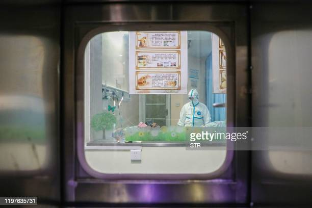 This photo taken on January 30 2020 shows a doctor working inside an isolation ward at a hospital in Wuhan in China's central Hubei province during...