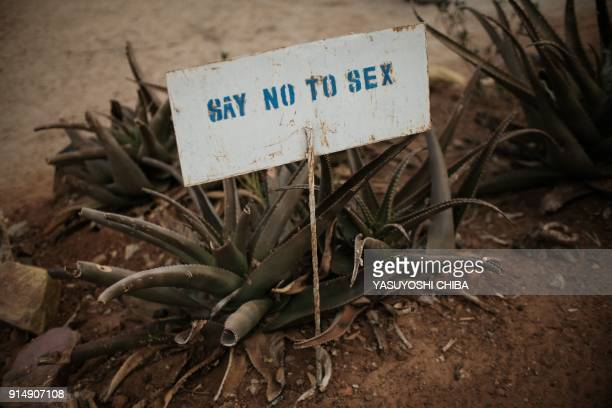 TOPSHOT This photo taken on January 31 2018 shows a message plate at Kalas Girl's primary school which hosts escaped girls from female genital...