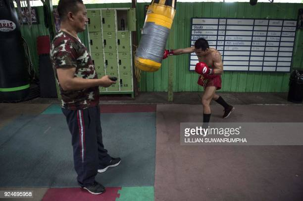 This photo taken on January 31 2018 shows the current World Boxing Council miniflyweight champion Wanheng Menayothin punching a bag whilst his...
