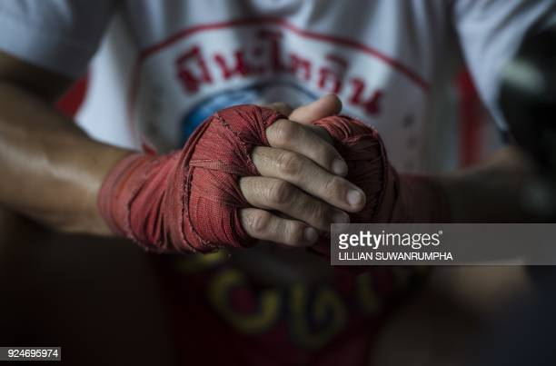 This photo taken on January 31 2018 shows the current World Boxing Council miniflyweight champion Wanheng Menayothin clasping his wrapped knuckles...
