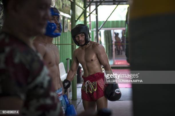 This photo taken on January 31 2018 shows the current World Boxing Council miniflyweight champion Wanheng Menayothin taking a break during a training...