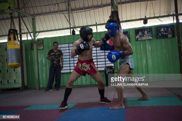 This photo taken on January 31 2018 shows the current World Boxing Council miniflyweight champion Wanheng Menayothin sparring with a fellow boxer...