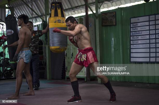 This photo taken on January 31 2018 shows the current World Boxing Council miniflyweight champion Wanheng Menayothin warming up during a training...