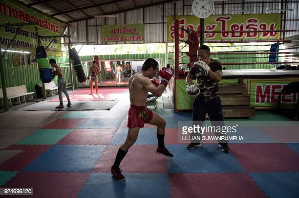 This photo taken on January 31 2018 shows the current World Boxing Council miniflyweight champion Wanheng Menayothin doing pad work with his trainer...