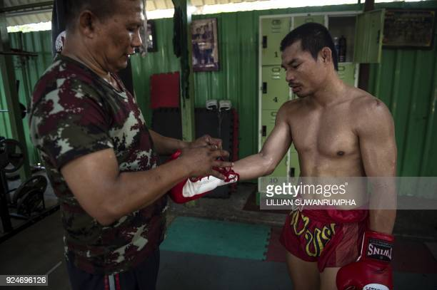 This photo taken on January 31 2018 shows the current World Boxing Council miniflyweight champion Wanheng Menayothin having his gloves adjusted...