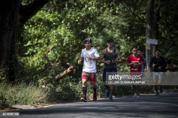 This photo taken on January 31 2018 shows the current World Boxing Council miniflyweight champion Wanheng Menayothin running with other boxers from...