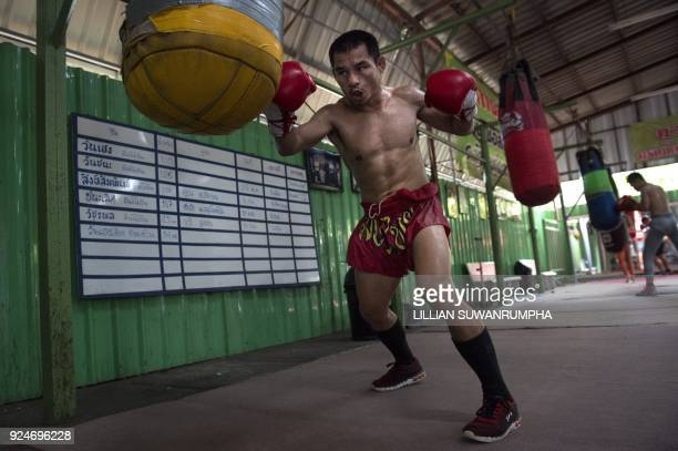 This photo taken on January 31 2018 shows the current World Boxing Council miniflyweight champion Wanheng Menayothin punching a bag during a training...
