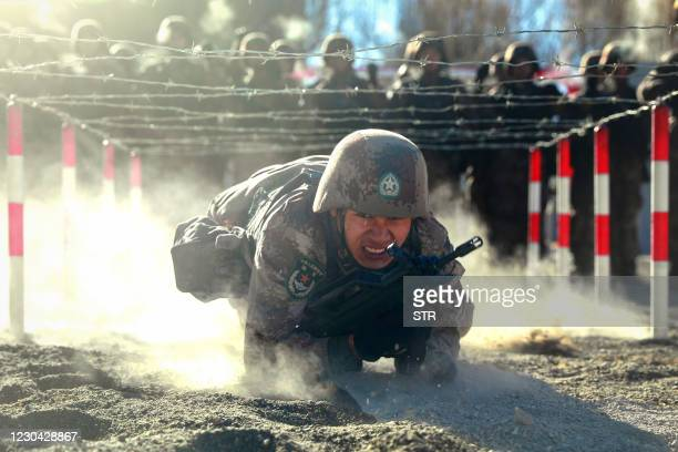 This photo taken on January 4, 2021 shows Chinese People's Liberation Army soldiers taking part in military training at Pamir Mountains in Kashgar,...