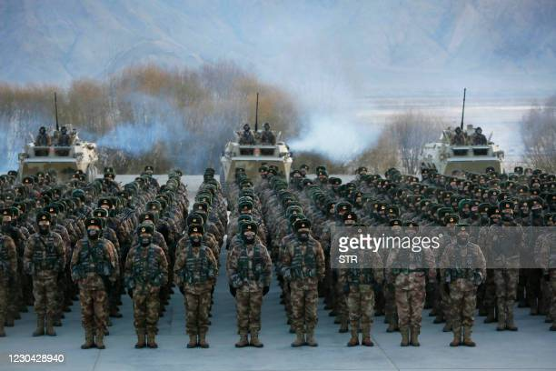 This photo taken on January 4, 2021 shows Chinese People's Liberation Army soldiers assembling during military training at Pamir Mountains in...