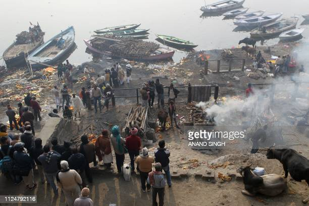 This photo taken on January 5 2019 shows bodies being cremated at Manikarnika Ghat in Varanasi About 20 men and women each month come from around the...