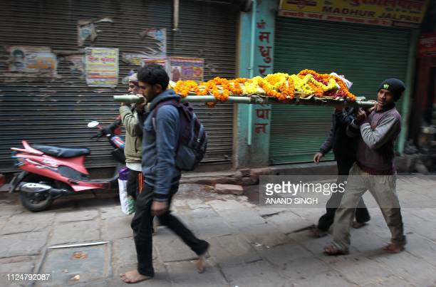 This photo taken on January 5 2019 shows relatives of Halkey Singh Raghuvansi carrying his body to be cremated at Manikarnika Ghat after he died at...