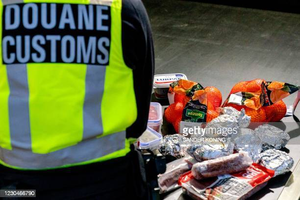 This photo taken on January 6 goods layed out as Dutch customs officer check vehicles coming off the ferry from the United Kingdom in Hoek van...