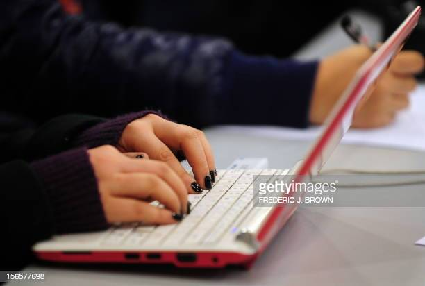 This photo taken on January 7 2010 shows a woman typing on the keyboard of her laptop computer in Beijing China declared its Internet 'open' on...