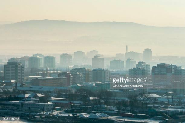 This photo taken on January 9 2018 shows the North Korean town of Sinuiju seen from Dandong in China's northeast Liaoning province Dandong has bet...