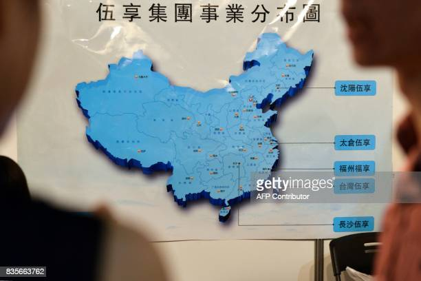 This photo taken on July 1 2017 shows visitors looking at a map of China during a jobs fair in Taipei Taiwan has long seen its international allies...