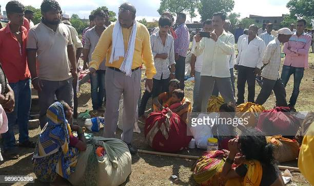 This photo taken on July 1 2018 shows Indian village leaders speaking to the relatives of men killed in a lynching incident in Dhule district some...