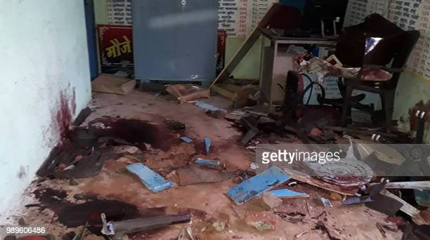 This photo taken on July 1 2018 shows pools of drying blood in a room at the crime scene where five men were murdered in a lynching incident in Dhule...